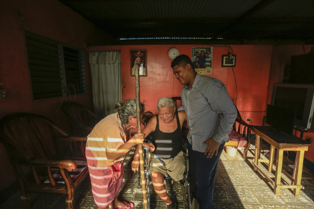 Martin Josue Paz, right, spends time with his grandparents Salvador del Carmen Paz, center, and Alba Aleman after being released from prison and place