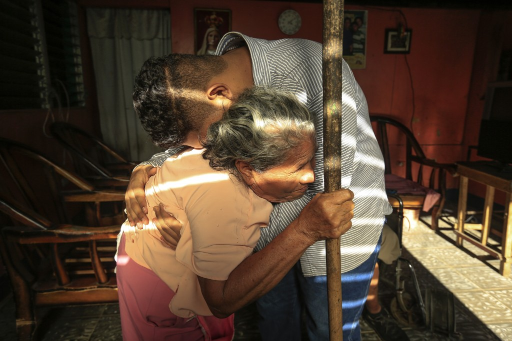 Martin Josue Paz embraces his grandmother Alba Aleman after he was released from prison and placed under house arrest, in Managua, Nicaragua, Friday,