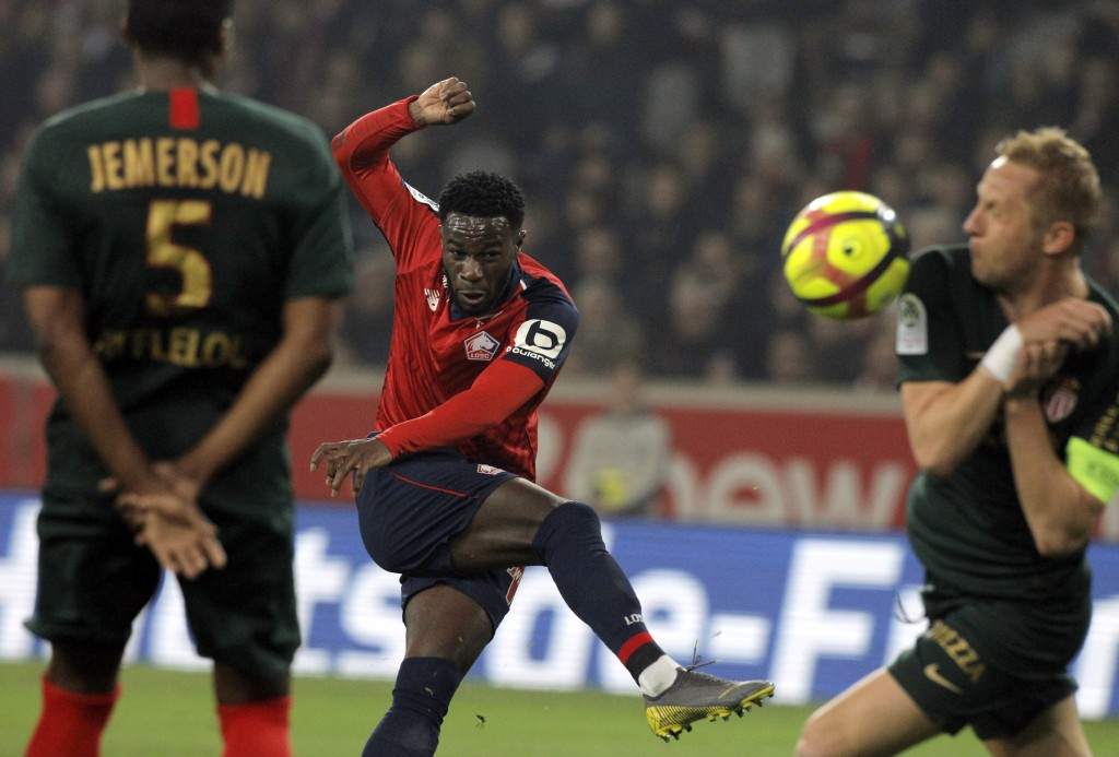Lille's Rafael Leao, center, attempts a shot on goal during the French League One soccer match between Lille and Monaco at the Lille Metropole stadium