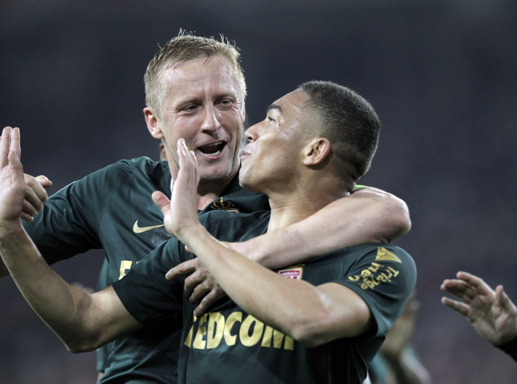 Monaco's players react after scoring during the French League One soccer match between Lille and Monaco at the Lille Metropole stadium, in Villeneuve