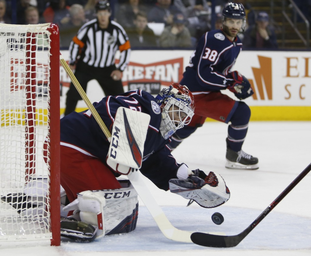 Columbus Blue Jackets' Sergei Bobrovsky, of Russia, makes a save against the Carolina Hurricanes during the first period of an NHL hockey game Friday,