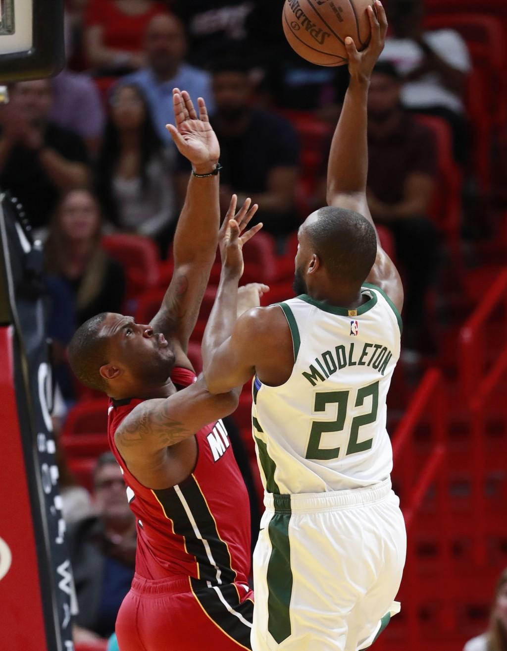 Milwaukee Bucks forward Khris Middleton (22) shoots against Miami Heat guard Dion Waiters during the first half of an NBA basketball game Friday, Marc