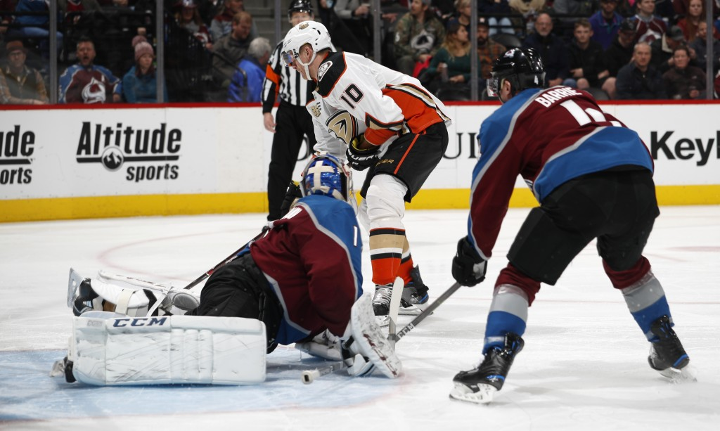 Anaheim Ducks right wing Corey Perry, back, shoots the puck for a goal past Colorado Avalanche goaltender Semyon Varlamov, front left, and defenseman