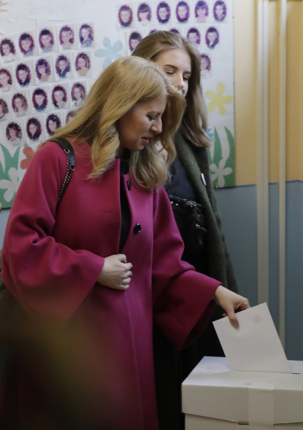 CAPTION CORRECTS THE LOCATION - Presidential candidate Zuzana Caputova casts her vote at a polling station during the first round of the presidential