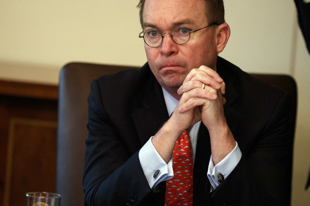 FILE - In this Jan. 2, 2019, file photo acting White House chief of staff Mick Mulvaney listens as President Donald Trump speaks during a cabinet meet