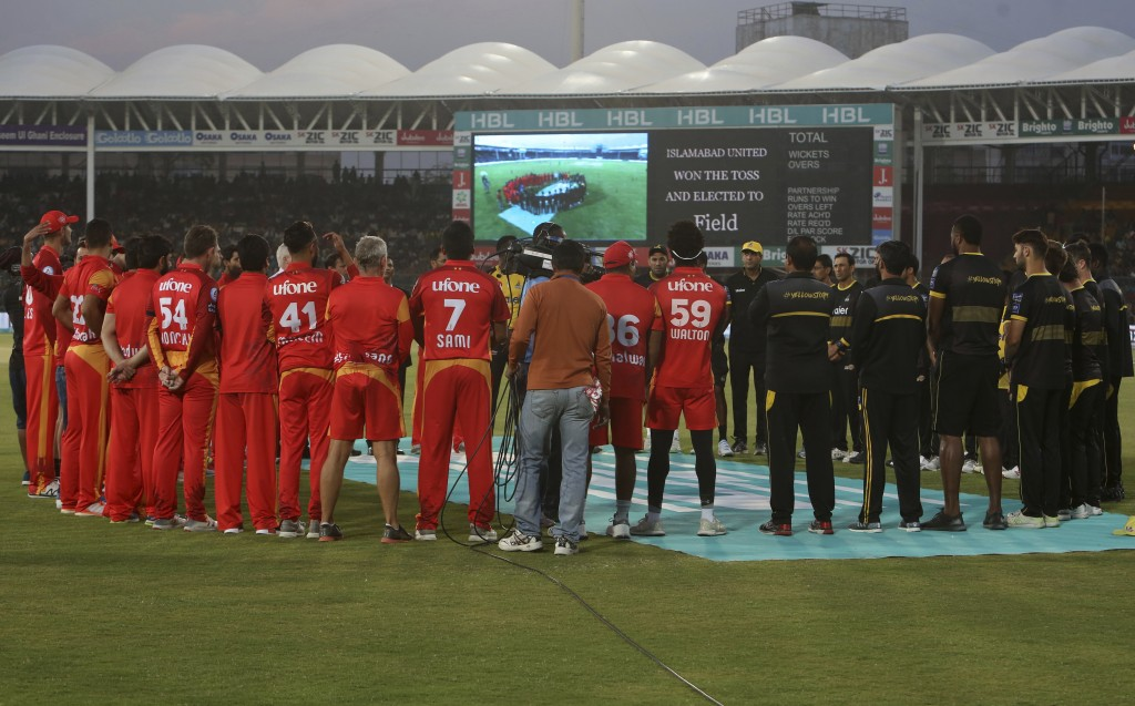 Players and officials of Islamabad United and Peshawar Zalmi observe a minute silence at National Stadium in Karachi on Friday, March 15, 2019 in memo