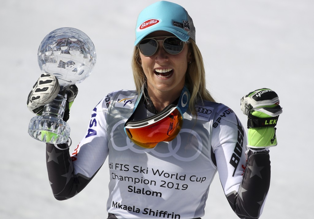 United States' Mikaela Shiffrin holds the women's World Cup slalom' discipline trophy, at the alpine ski, World Cup finals in Soldeu, Andorra, Saturda