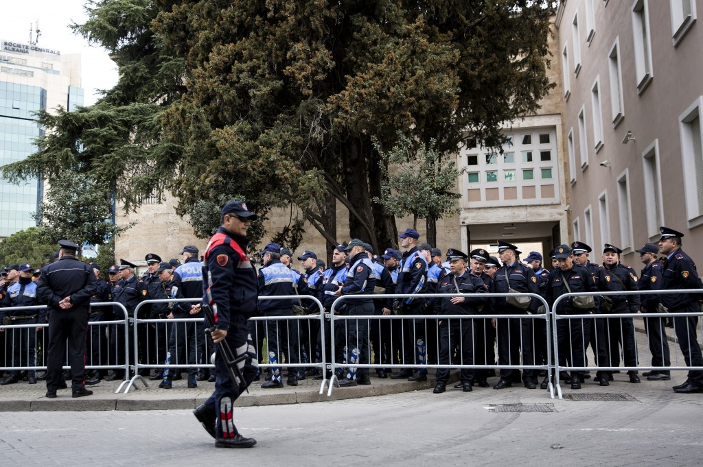 Policemen line up outside the Prime Minister's office ahead of an anti-government rally in Tirana, Albania on Saturday, March 16, 2019. The center-rig