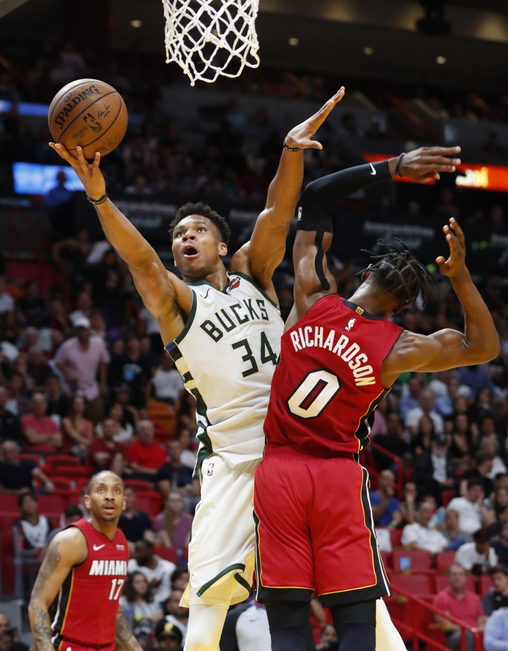 Milwaukee Bucks forward Giannis Antetokounmpo (34) goes up for a shot against Miami Heat guard Josh Richardson (0) during the second half of an NBA ba