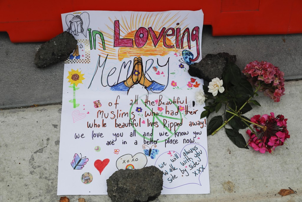 A message is displayed at a makeshift memorial outside Christchurch hospital in Christchurch, New Zealand, Saturday, March 16, 2019, one day after the