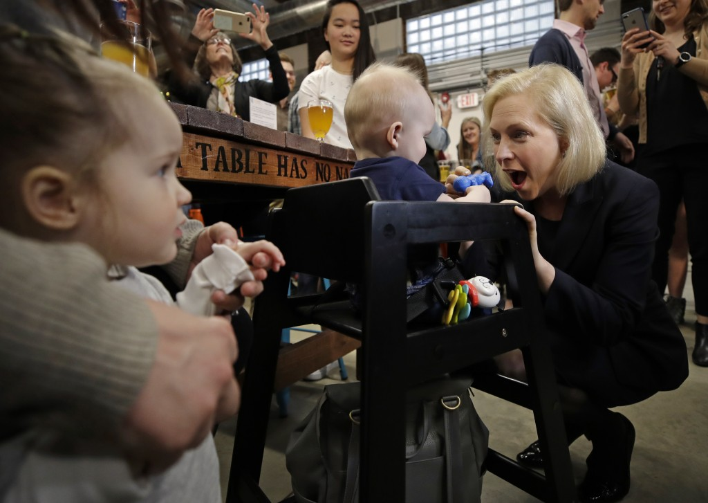 Democratic presidential candidate Sen. Kirsten Gillibrand, D-N.Y., plays with 7-month-old Bodie Nichols of Bedford, N.H. as his sister Emmie, 2, watch