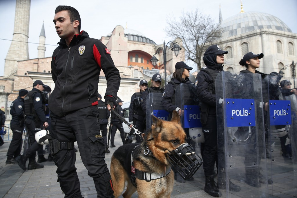 Backdropped by the Byzantine-era Hagia Sophia, Turkish police officers provide security during a protest against the mosque attacks in New Zealand in