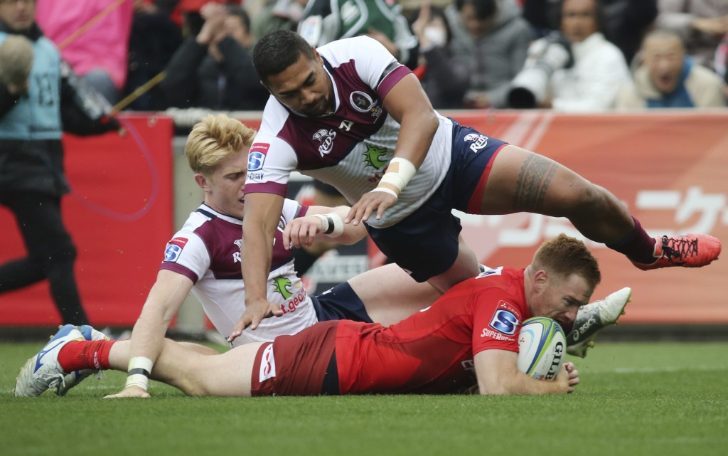 Jamie Booth of Sunwolves scores a try against Reds during their Super Rugby match in Tokyo, Saturday, March 16, 2019. (AP Photo/Koji Sasahara)