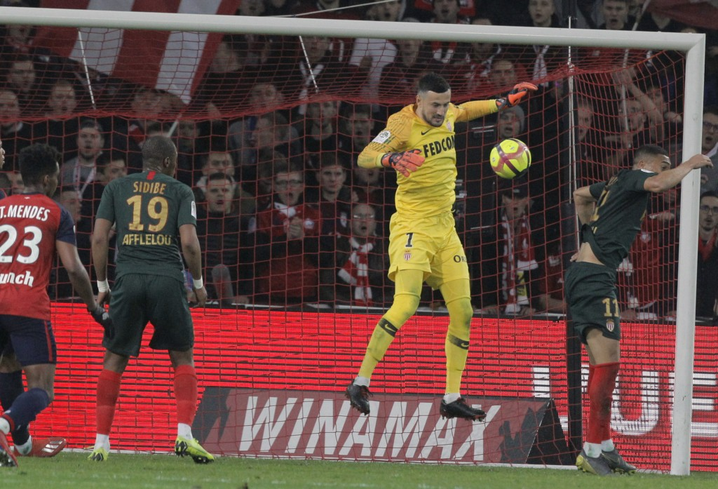 Monaco's goalkeeper Daniel Subasic controls the ball during the French League One soccer match between Lille and Monaco at the Lille Metropole stadium