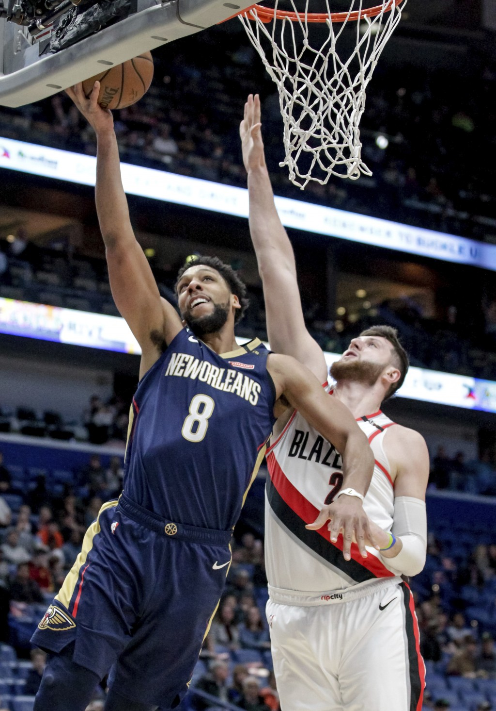 New Orleans Pelicans center Jahlil Okafor (8) scores over Portland Trail Blazers center Jusuf Nurkic (27) in the first half of an NBA basketball game