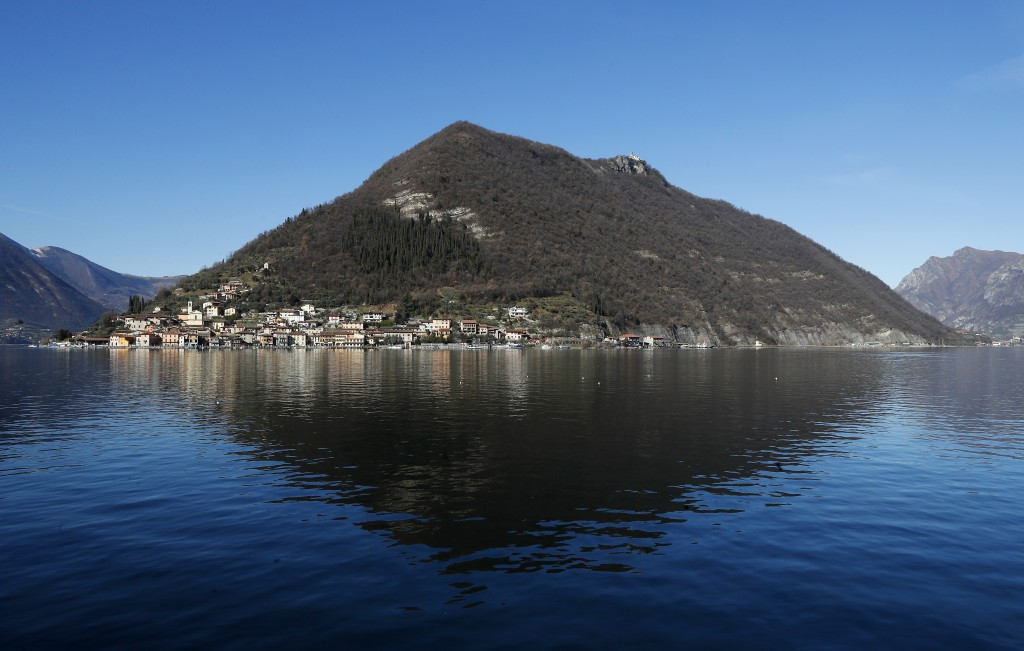 In this photo taken on Wednesday, Feb. 6, 2019, a view of Monte Isola, Lake Iseo, northern Italy. Step off the ferry onto Monte Isola and it feels lik