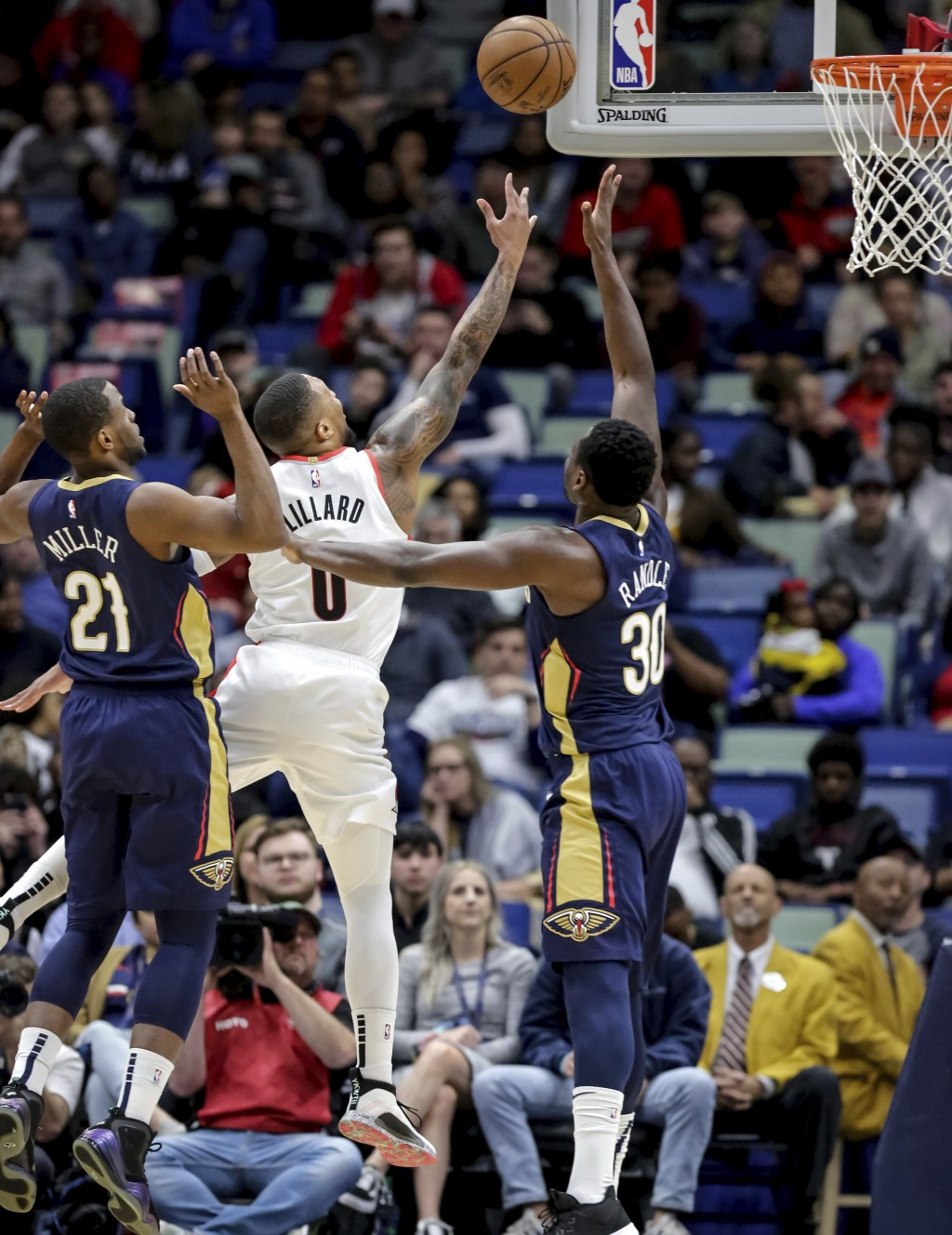 Portland Trail Blazers guard Damian Lillard (0) shoots over New Orleans Pelicans center Julius Randle (30) and forward Darius Miller (21) in the first