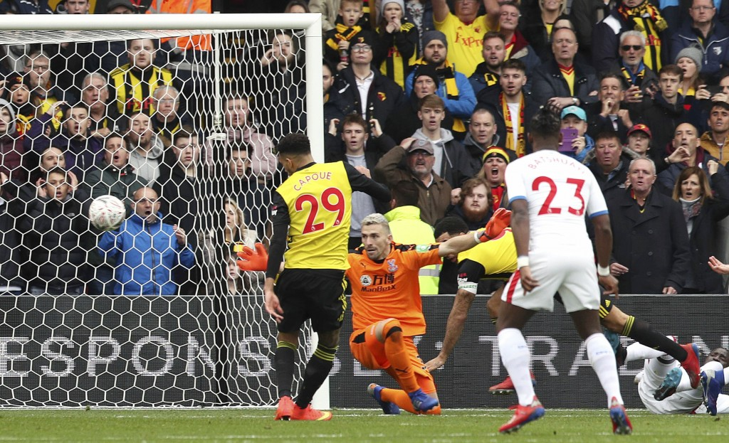 Watford's Etienne Capoue scores his side's first goal of the game  during the FA Cup quarter final soccer match between Watford and Crystal Palace , a