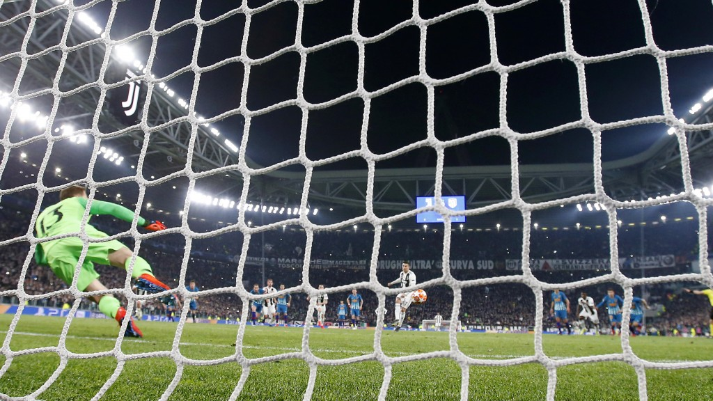 "In this photo taken on Tuesday, March 12, 2019 through a net made by ""La Rete"" factory, Juventus' Cristiano Ronaldo scores on a penalty kick during th"