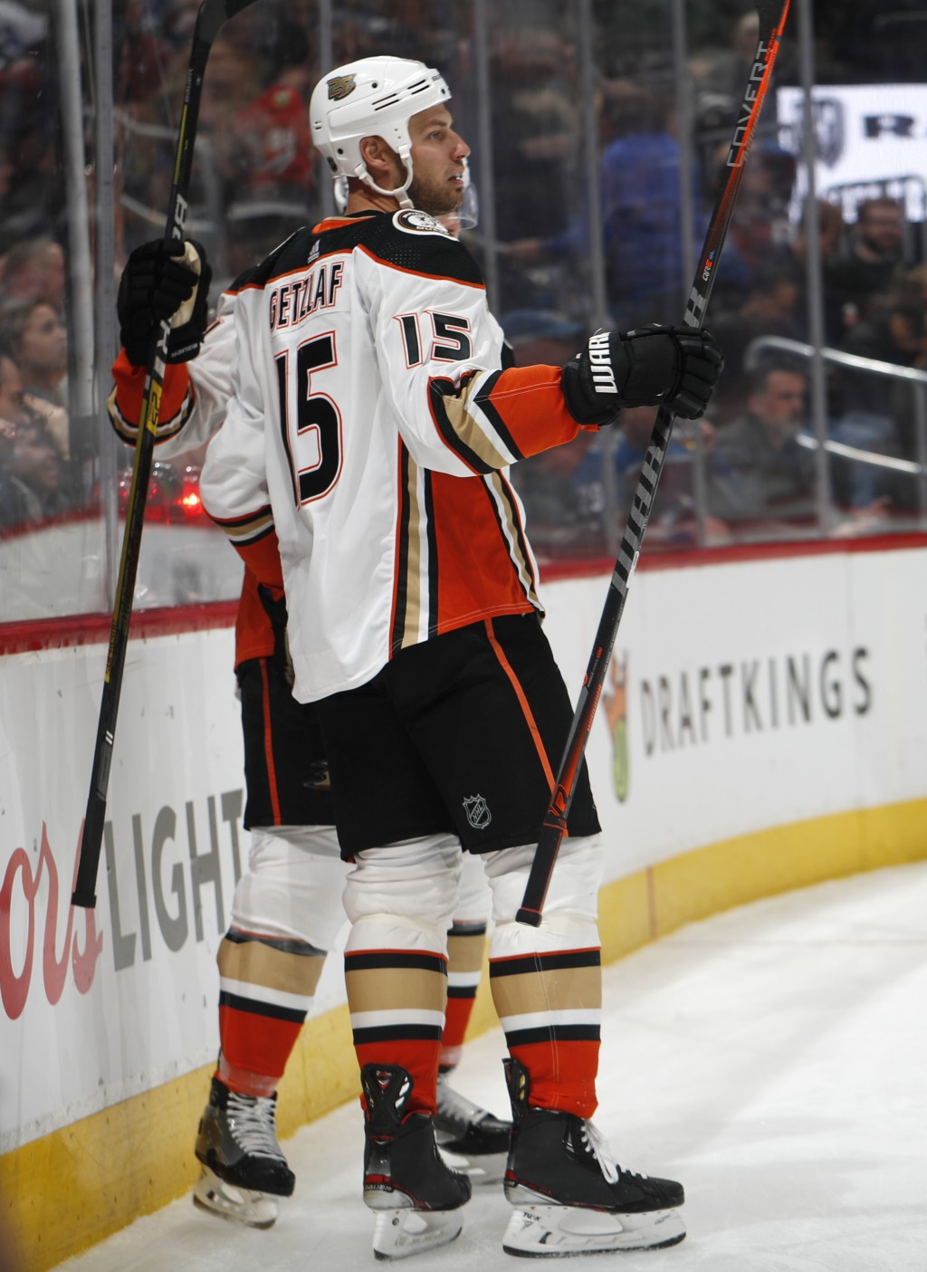 Anaheim Ducks center Ryan Getzlaf, front, celebrates his goal with defenseman Cam Fowler during the second period of an NHL hockey game against the Co
