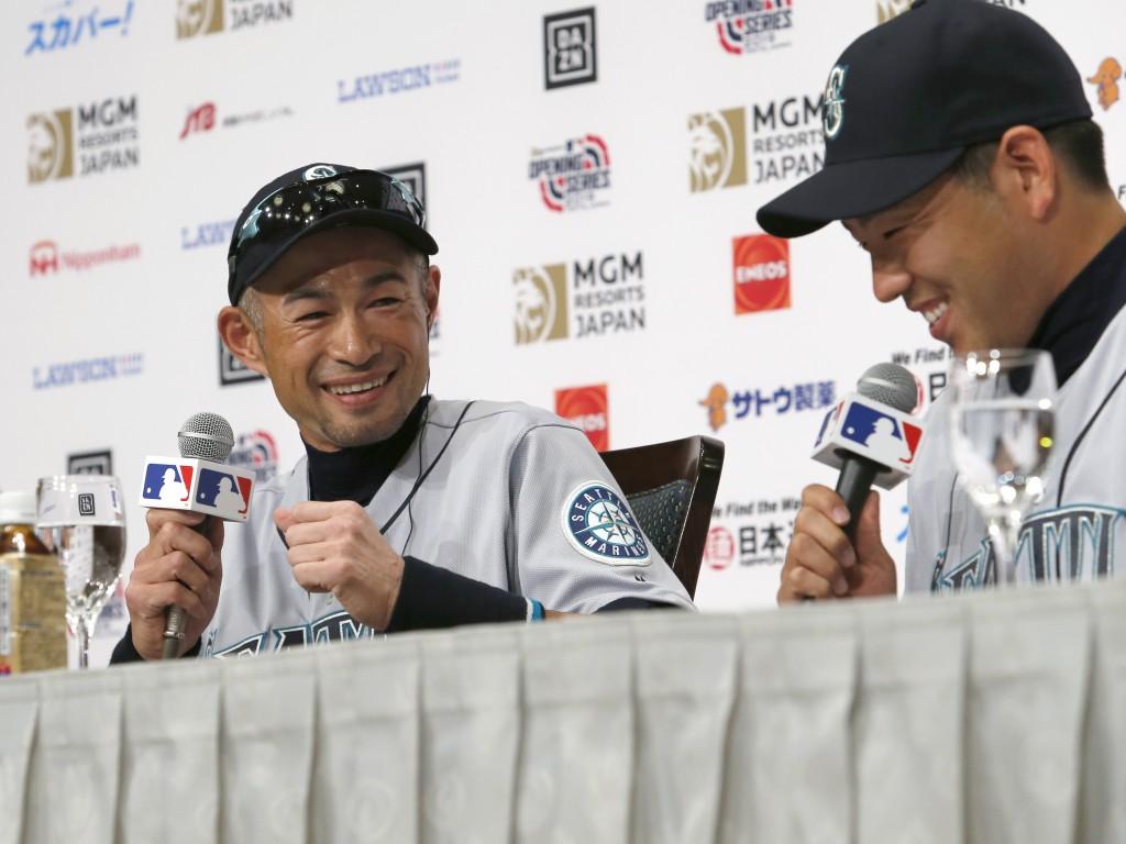 Seattle Mariners' Ichiro Suzuki, left, and pitcher Yusei Kikuchi laugh during a press conference in Tokyo Saturday, March 16, 2019. The Mariners will