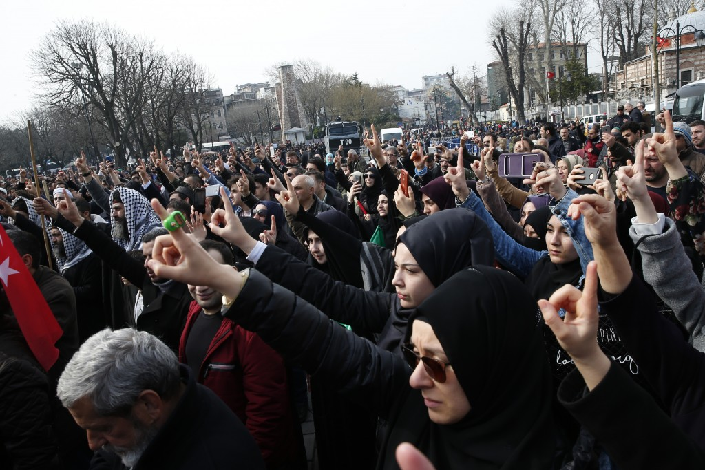 Demonstrators chant slogans against the mosque attacks in New Zealand during a protest in Istanbul, Saturday, March 16, 2019. World leaders expressed