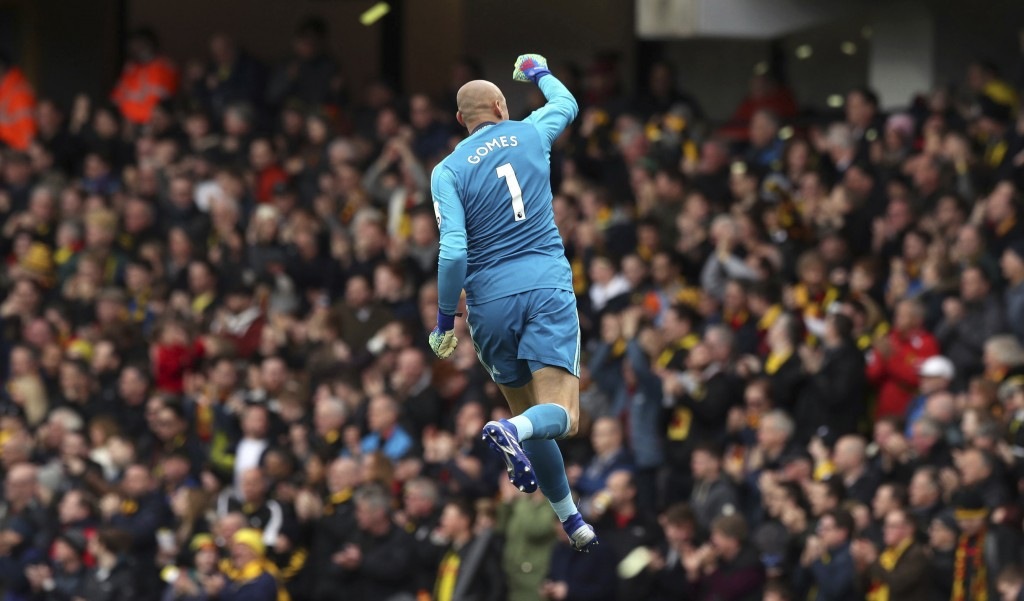 Watford goalkeeper Heurelho Gomes celebrates after teammate Etienne Capoue scores his side's first goal of the game  during the FA Cup quarter final s