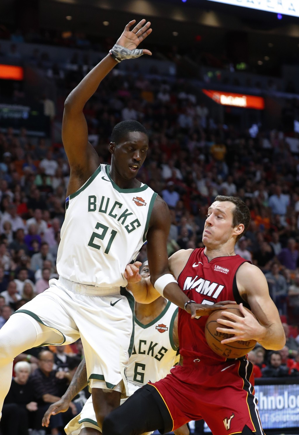 Miami Heat guard Goran Dragic goes up for a shot against Milwaukee Bucks guard Tony Snell (21) during the first half of an NBA basketball game Friday,