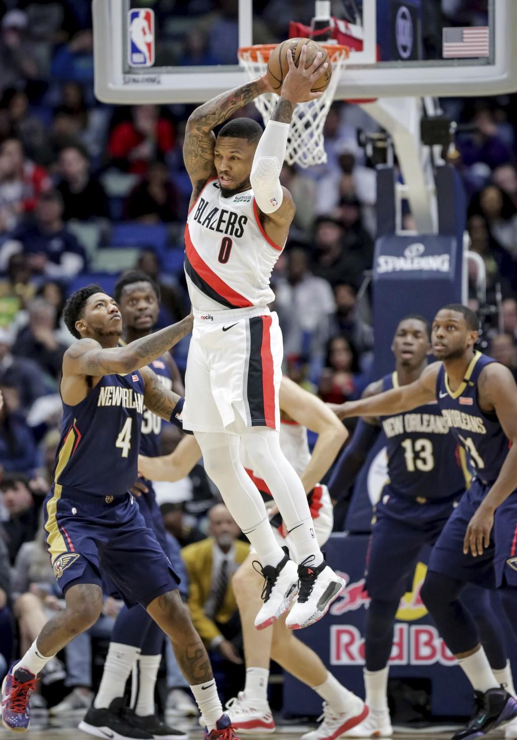 Portland Trail Blazers guard Damian Lillard (0) grabs a rebound against New Orleans Pelicans guard Elfrid Payton (4) in the first half of an NBA baske