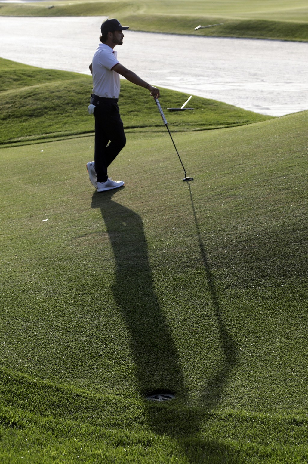 Abraham Ancer casts a shadow as he waits to hit on the seventh green during the second round of The Players Championship golf tournament Friday, March