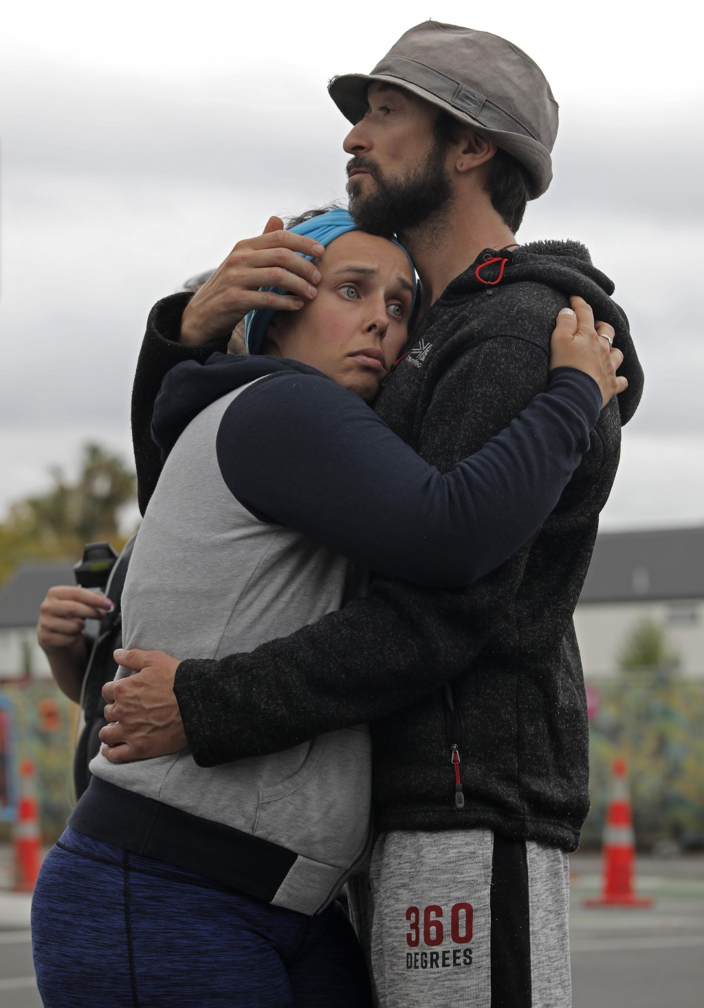 Mourners hug as they pay their respects at a memorial near the Masjid Al Noor mosque in Christchurch, New Zealand, Saturday, March 16, 2019, near wher