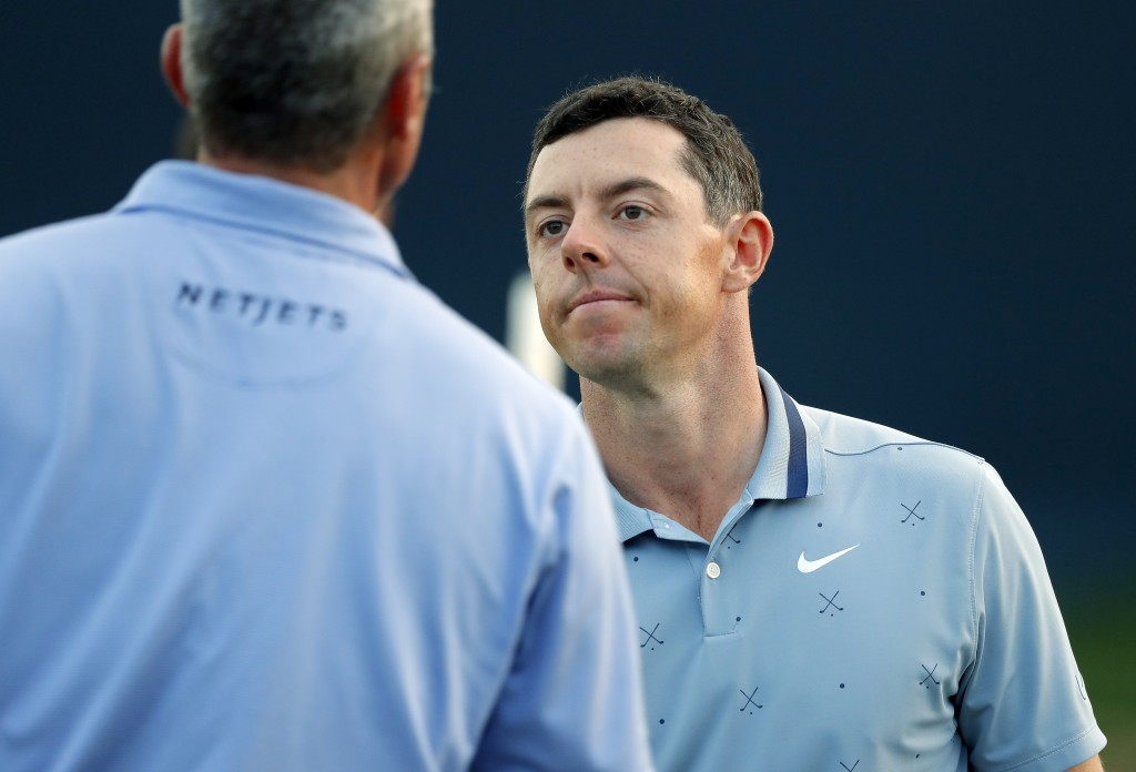 Rory McIlroy, of Northern Ireland, right, congratulates Matt Kuchar after their round during the second round of The Players Championship golf tournam