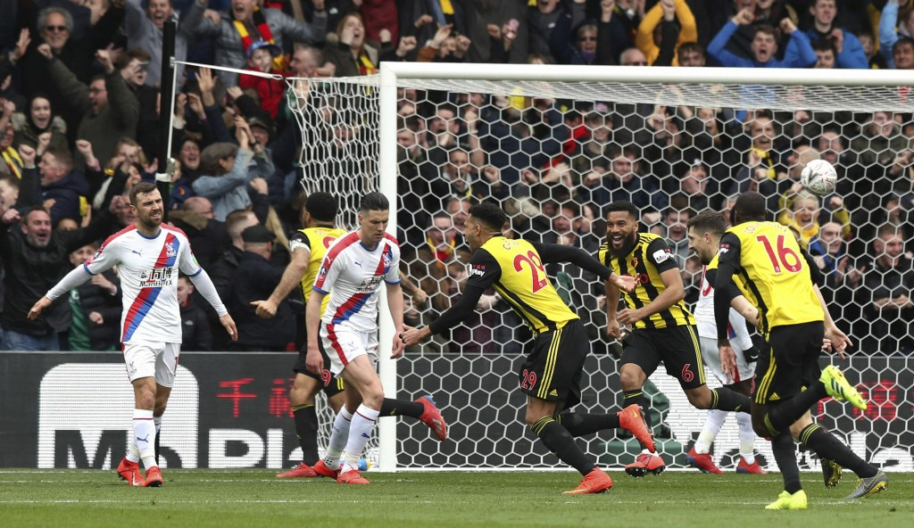 Watford's Etienne Capoue, centre, celebrates scoring his side's first goal of the game, during the FA Cup quarter final soccer match between Watford a