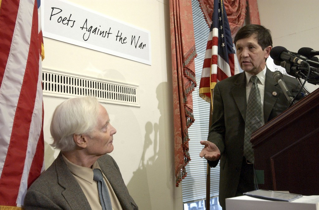 FILE -- In this March 5, 2003 file photo, U.S. Rep. Dennis Kucinich, D-Ohio, right, gestures toward Pulitzer Prize winning poet W.S. Merwin during a C
