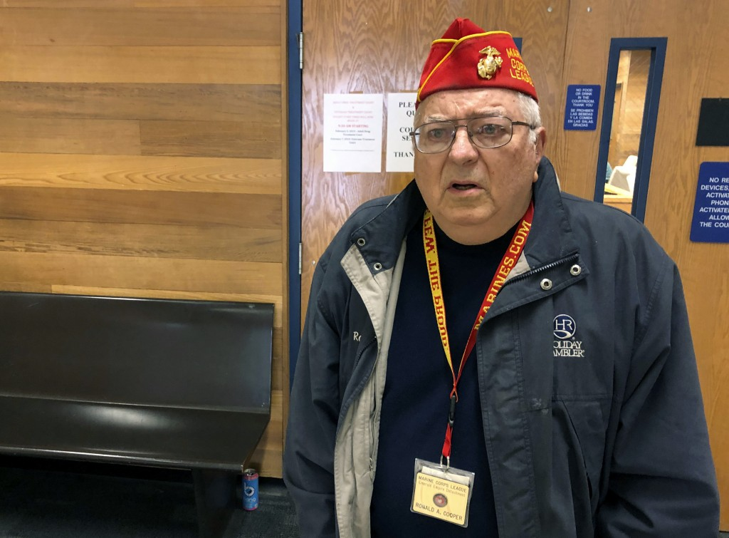 In this photo taken March 7, 2019, Marine veteran Ronald Cooper stands during an interview in front of the courtroom where the Veterans Treatment Cour