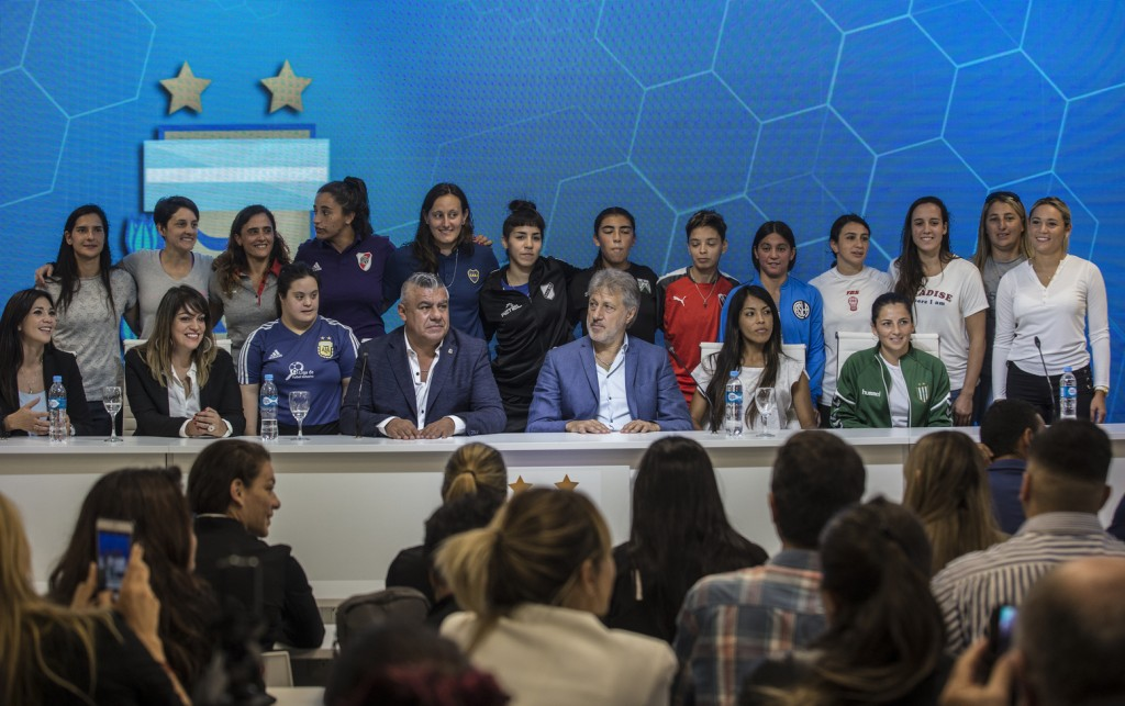 Accompanied by soccer players, Claudio Tapia, president of Argentina's Soccer Federation, bottom center, and General Secretary of the Argentina's Foot
