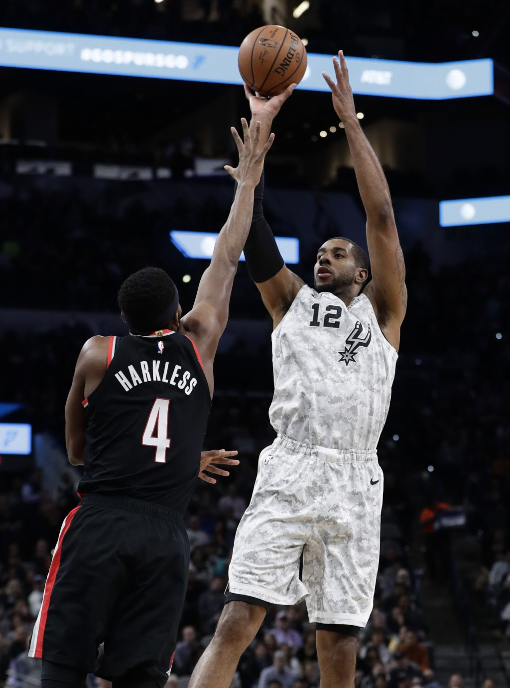 San Antonio Spurs center LaMarcus Aldridge (12) shoots over Portland Trail Blazers forward Maurice Harkless (4) during the first half of an NBA basket