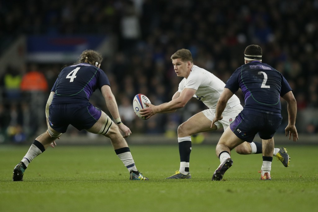 England's Owen Farrell plays the ball during the Six Nations rugby union international between England and Scotland at Twickenham stadium in London, S
