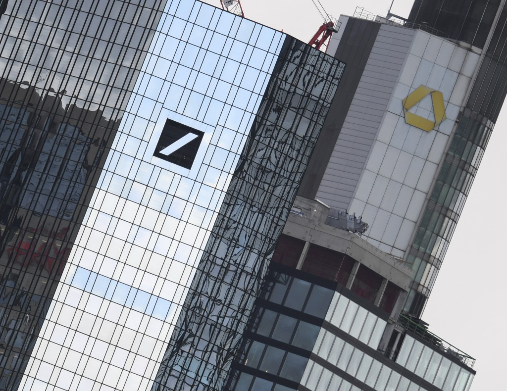 File-Picture taken March 11, 2019 shows the head offices of Deutsche Bank, left, and Commerzbank, right. (Arne Dedert/dpa via AP)