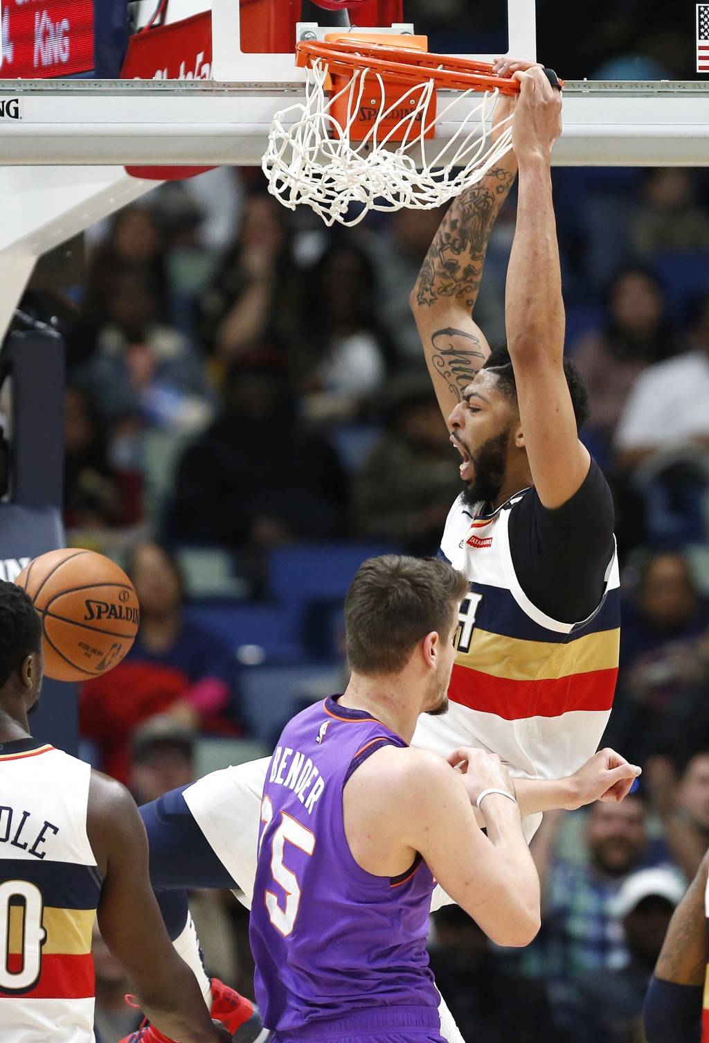 New Orleans Pelicans forward Anthony Davis (23) dunks the ball over Phoenix Suns forward Dragan Bender (35) during the first half of an NBA basketball