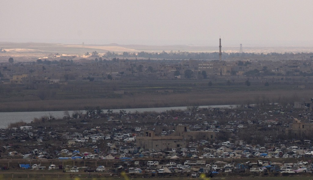 The Islamic State group's last pocket of territory in Baghouz, Syria, as seen from a distance on Sunday, March 17, 2019. U.S.-backers forces fighting