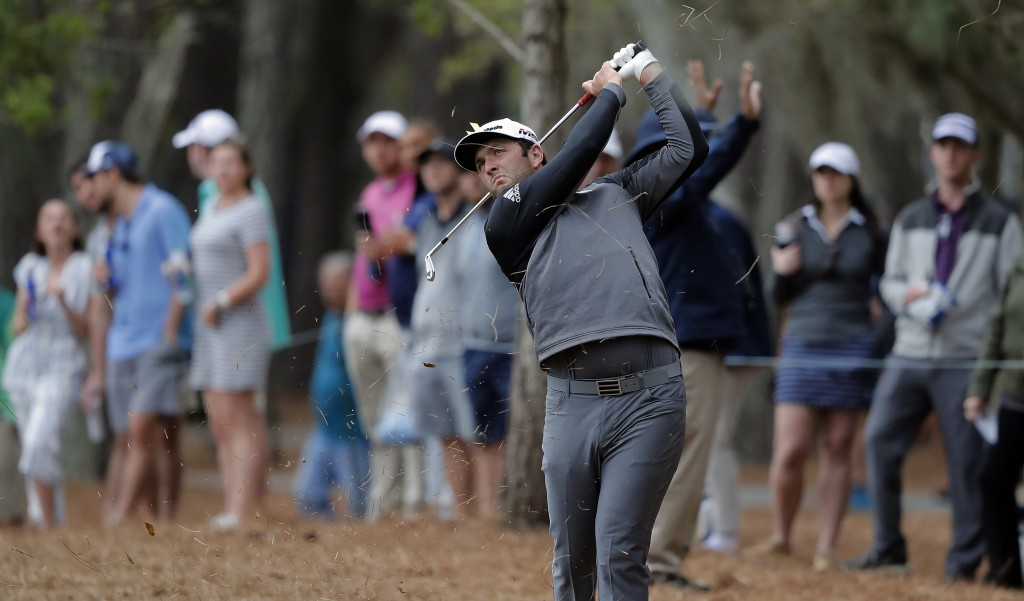 Jon Rahm, of Spain, hits from the pinestraw along the 15th hole during the third round of The Players Championship golf tournament Saturday, March 16,