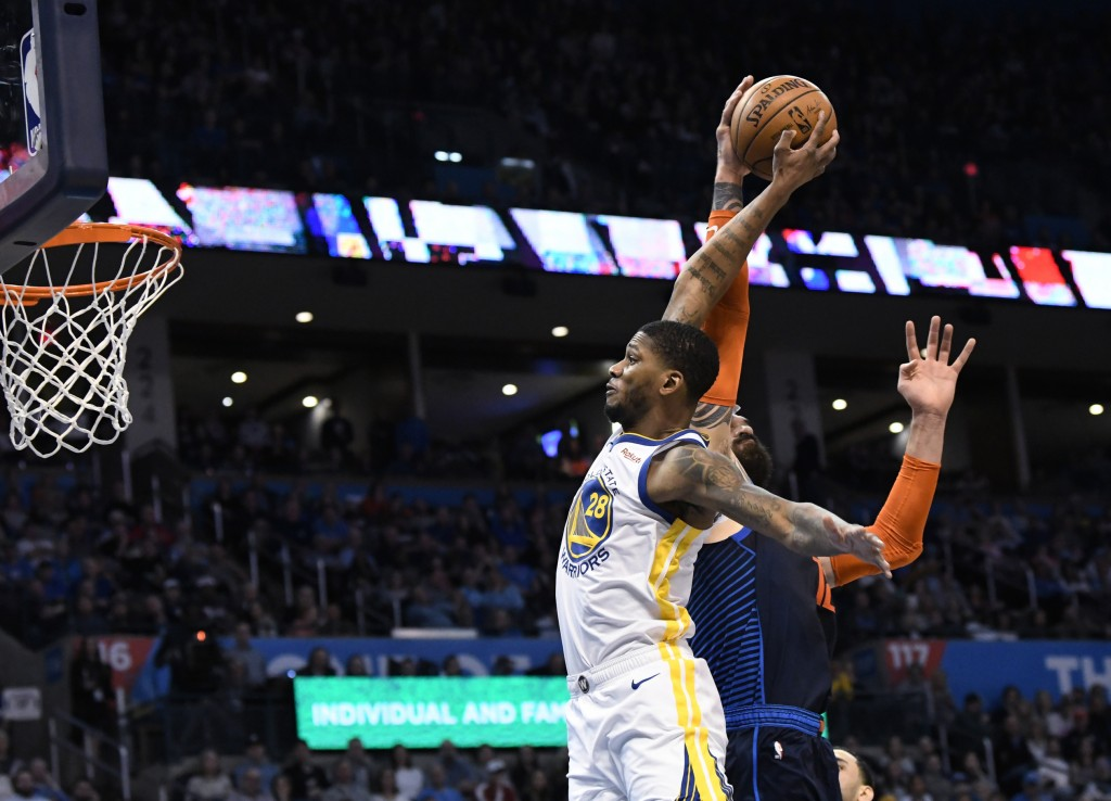 Oklahoma City Thunder center Steven Adams (12) blocks a shot by Golden State Warriors forward Alfonzo McKinnie (28) during the first half of an NBA ba