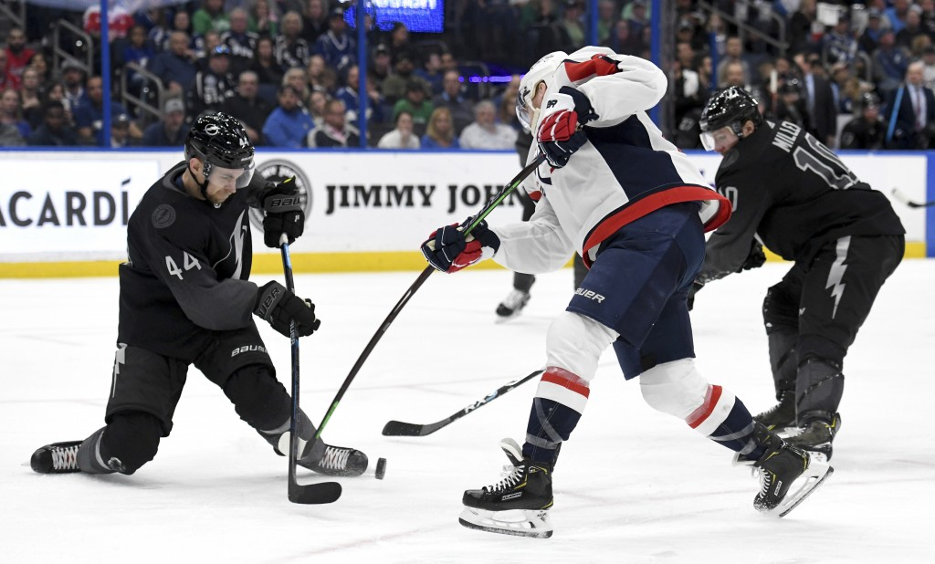 Tampa Bay Lightning defenseman Jan Rutta (44) blocks a shot from Washington Capitals center Travis Boyd (72) during the third period of an NHL hockey