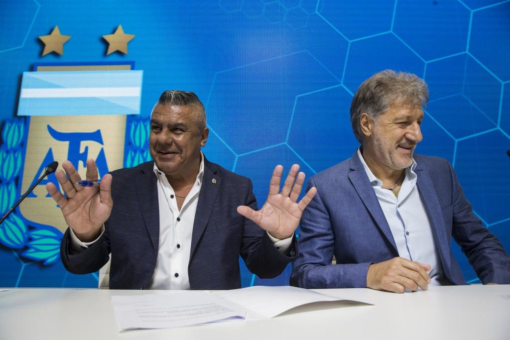 Claudio Tapia, president of Argentina's Soccer Federation, left, and General Secretary of the Argentina's Footballers' Union (FAA) Sergio Marchi, take...