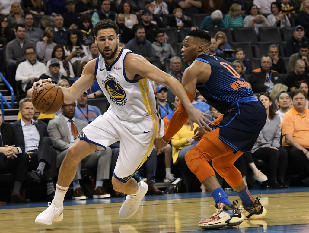 Oklahoma City Thunder guard Russell Westbrook (0) defends against Golden State Warriors guard Klay Thompson (11) during the first half of an NBA baske