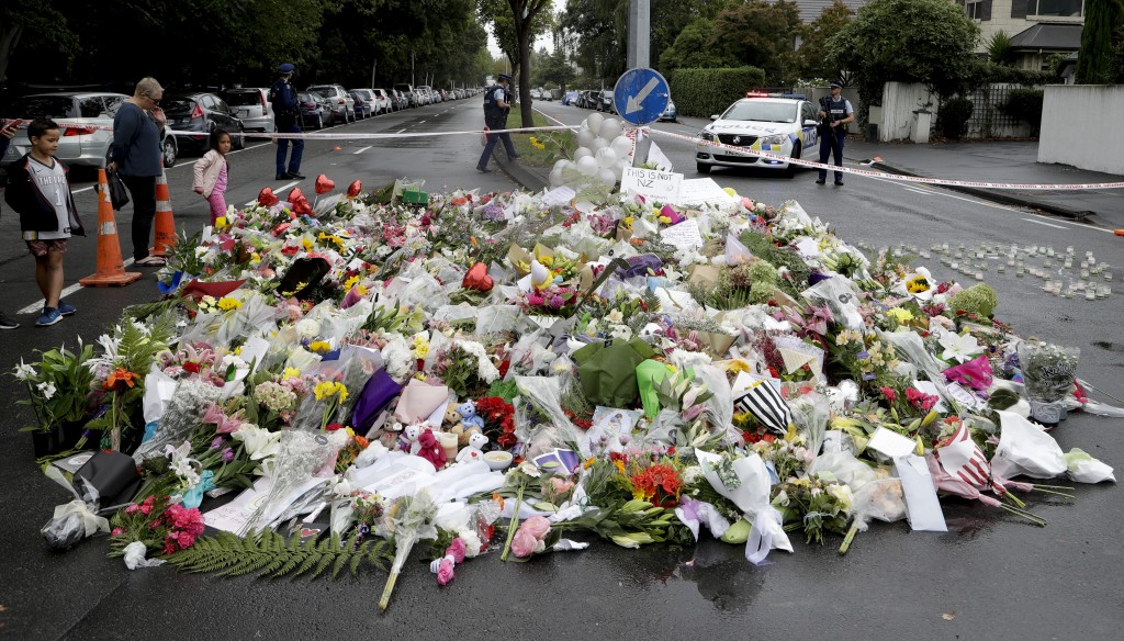 Mourners place flowers as they pay their respects at a makeshift memorial near the Masjid Al Noor mosque in Christchurch, New Zealand, Sunday, March 1