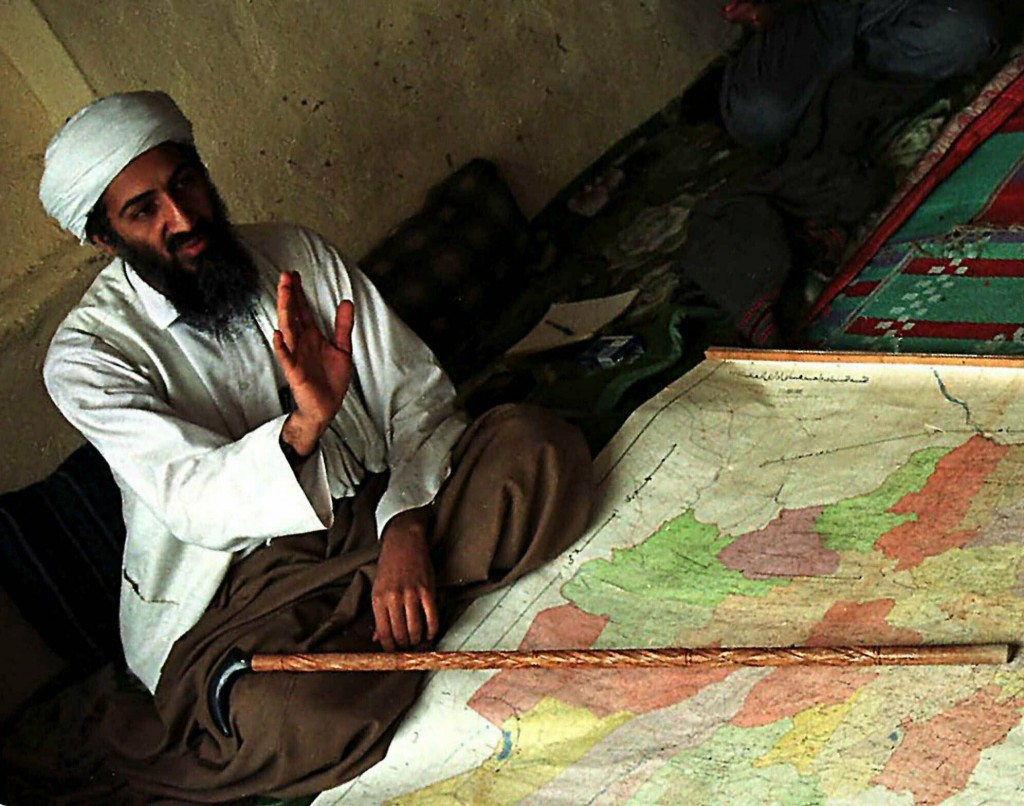 FILE - In this April 1998 file photograph, al-Qaida leader Osama bin Laden is shown in Afghanistan. Years after the death of his father at the hands o