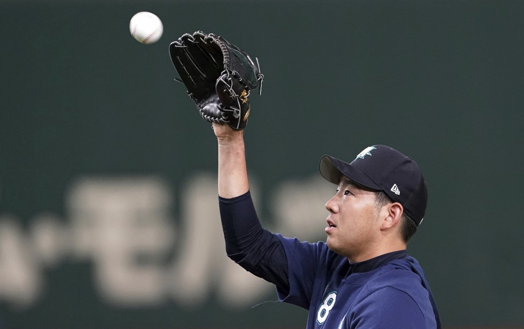 Seattle Mariners pitcher Yusei Kikuchi catches a ball during his team's practice at Tokyo Dome in Tokyo, Saturday, March 16, 2019. Just as he was adju