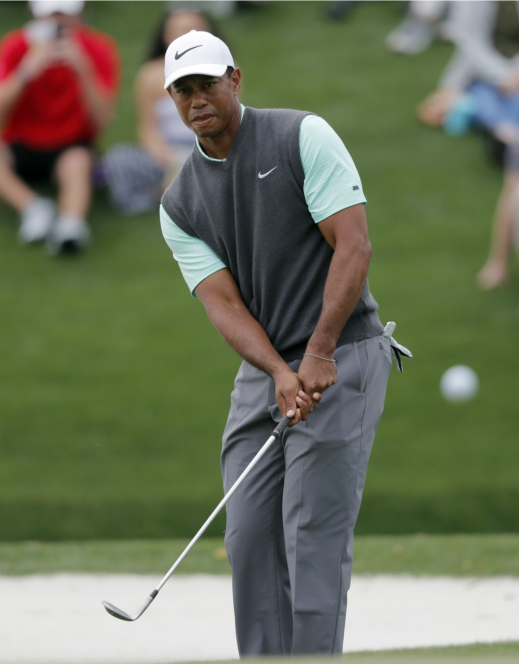 Tiger Woods chips onto the third green during the third round of The Players Championship golf tournament Saturday, March 16, 2019, in Ponte Vedra Bea...